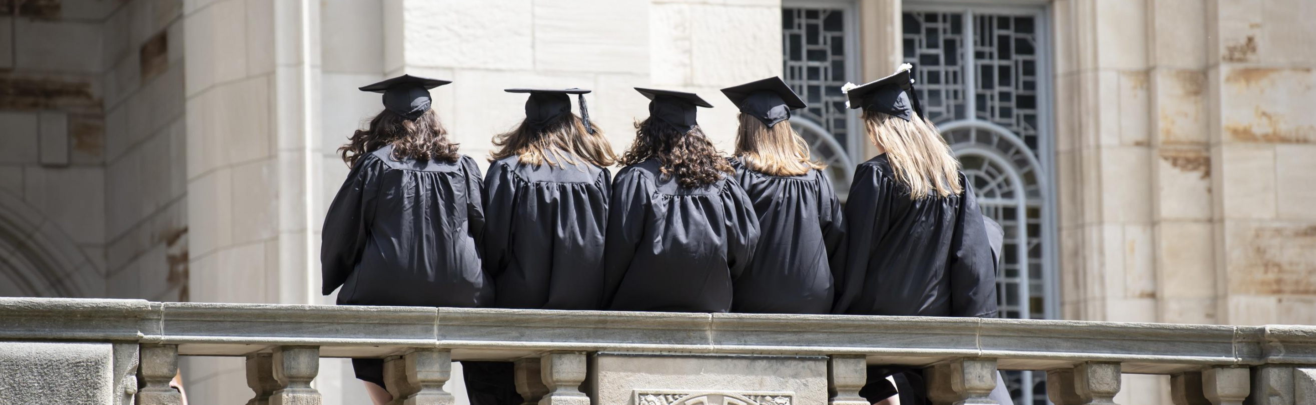Graduates posing in their caps and gowns