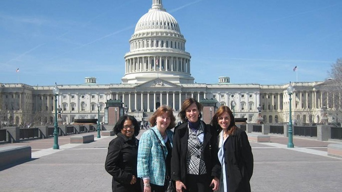 HIM Faculty and alum in front of Capitol in Washington DC
