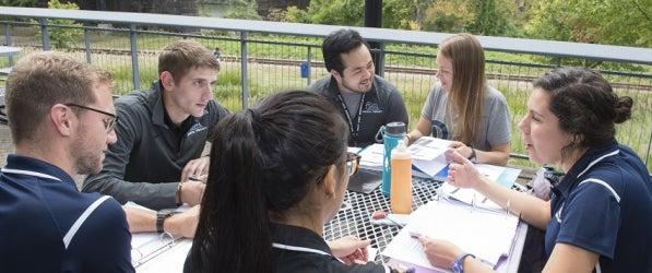 DPT Students around table talking