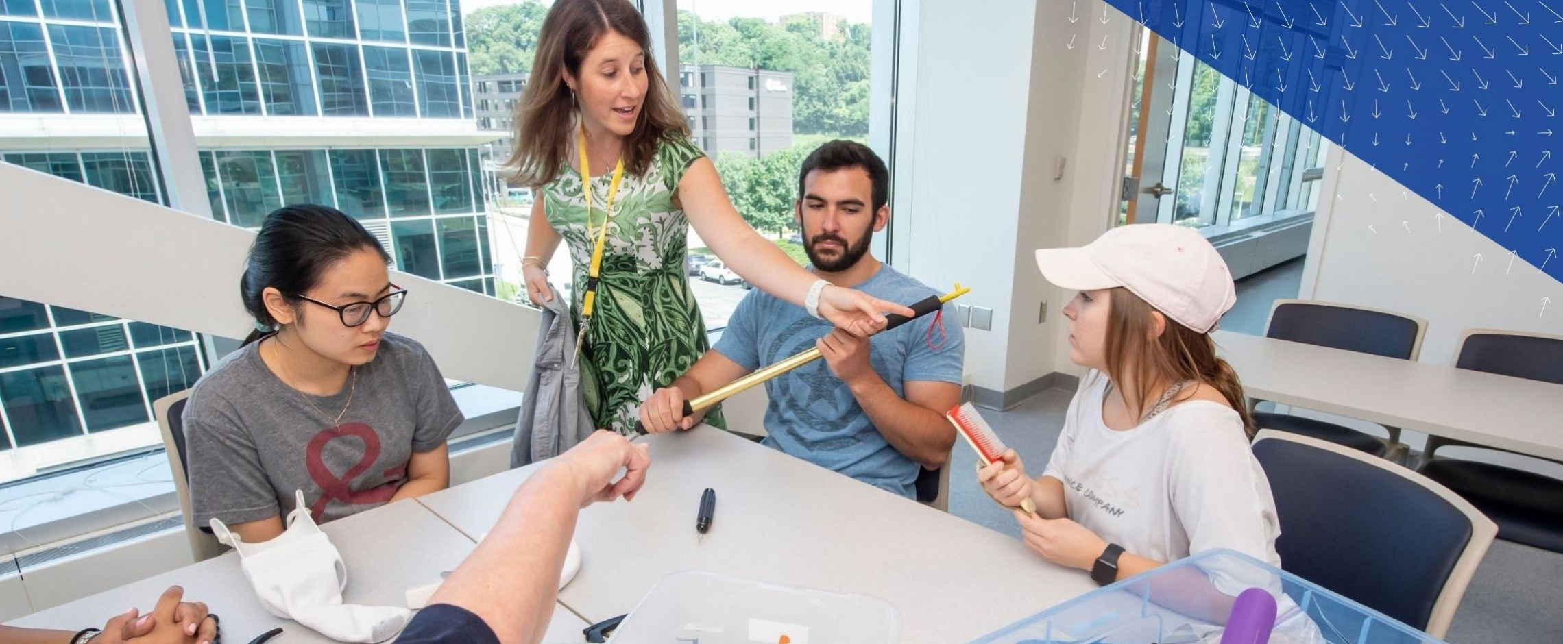 OT instructor showing students how to use assistive devices
