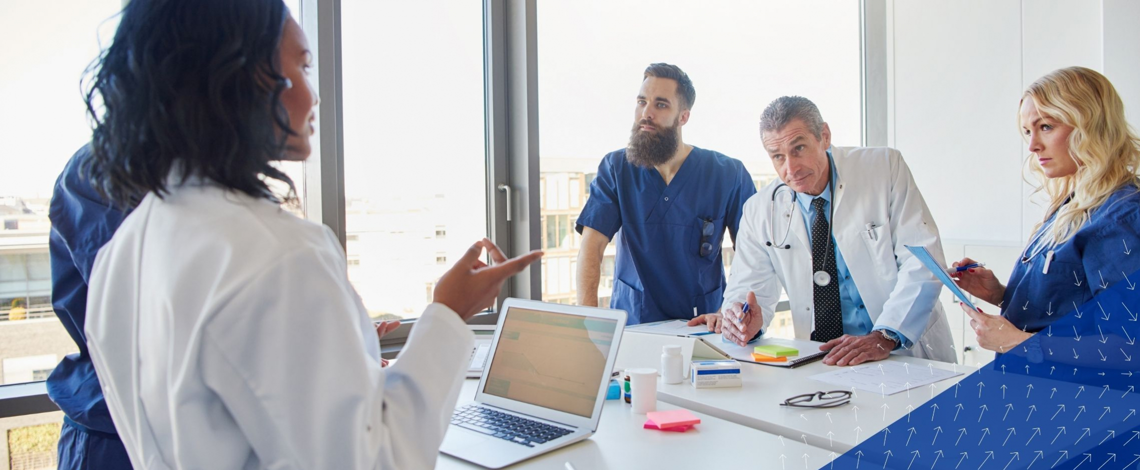 Physician assistant leading a team of physicians