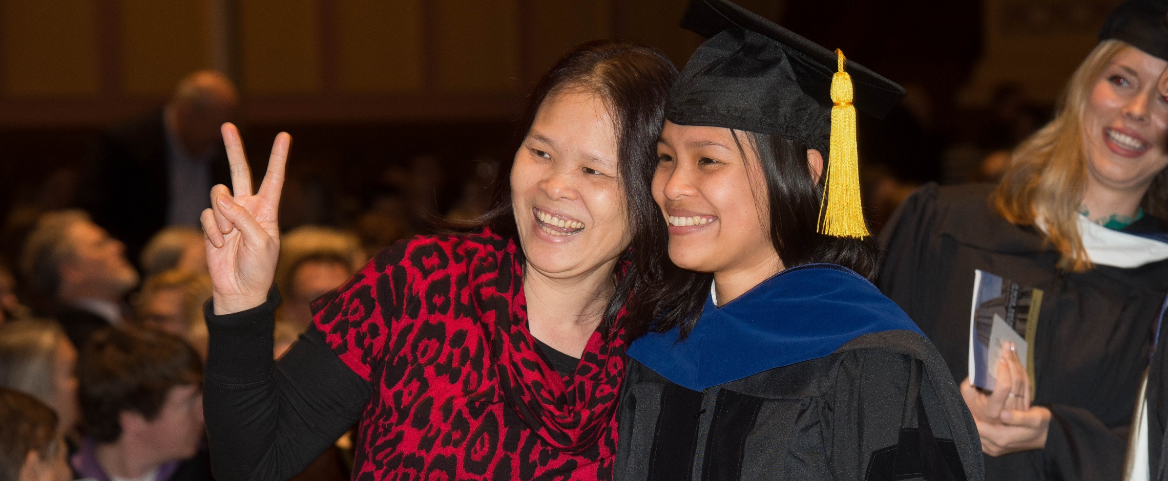 Grad with family member