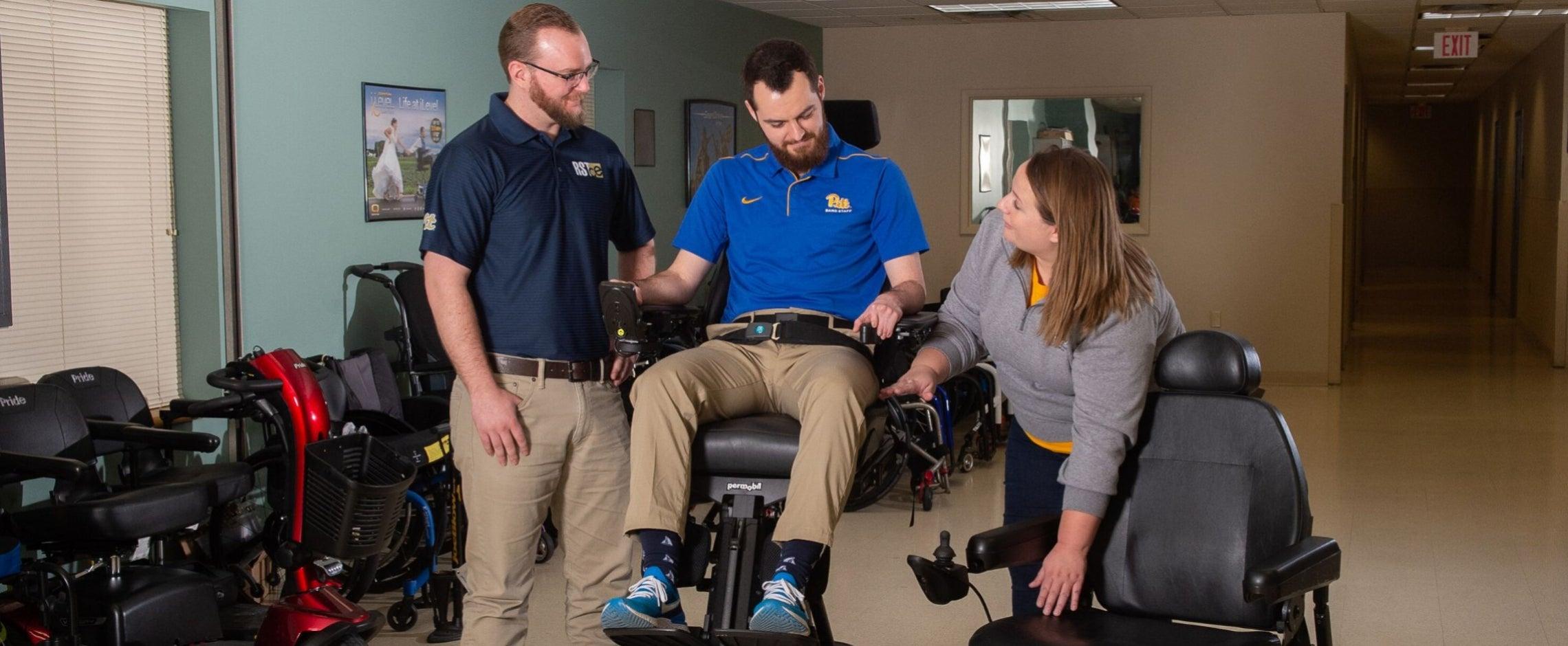 Rehab engineers explaining power wheelchair