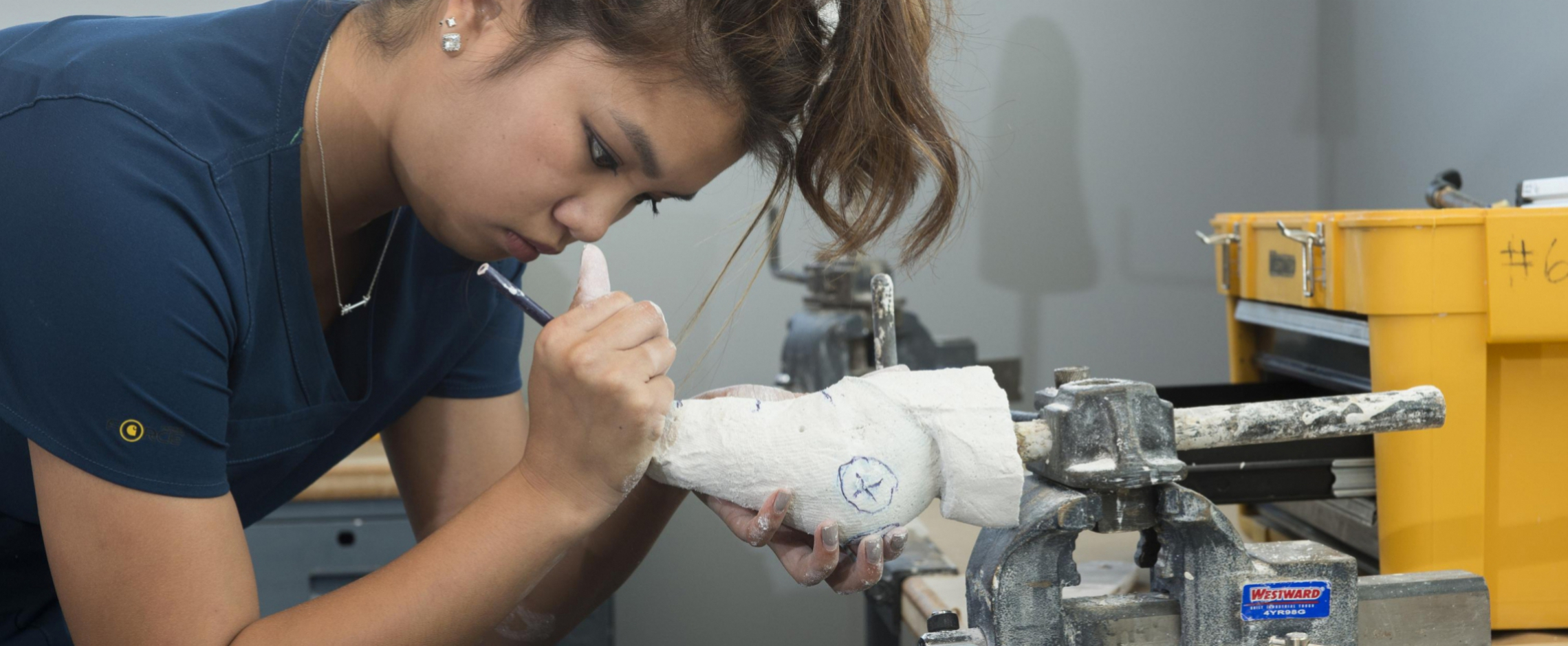 Student working with casting