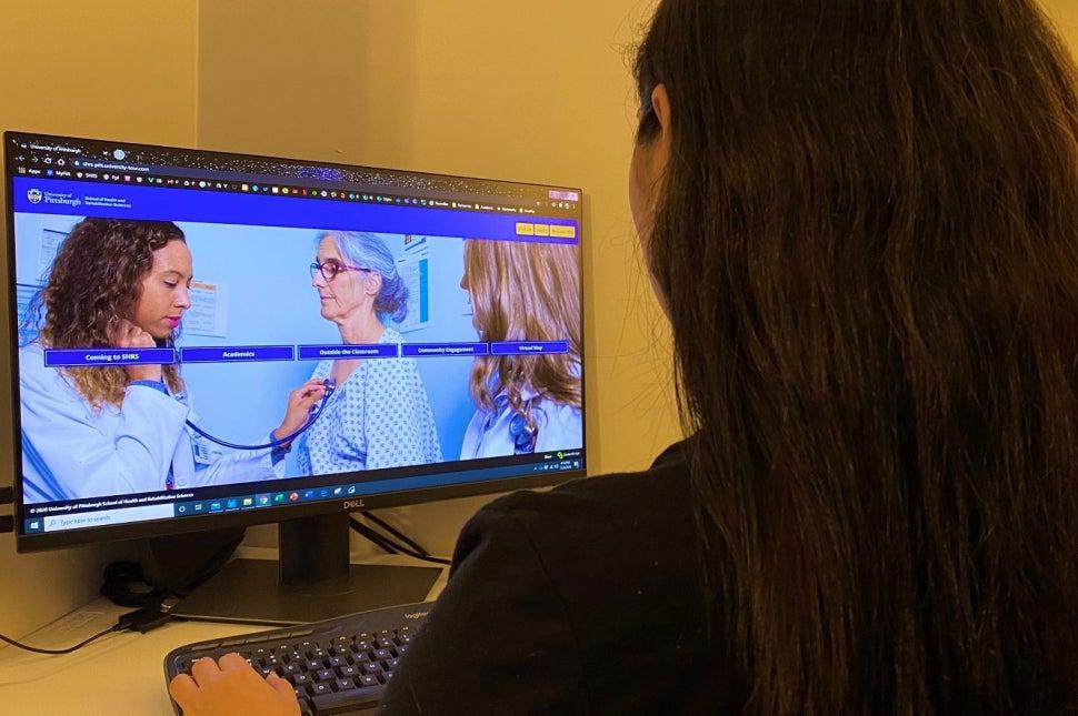 Student Looking at StudentBridge website