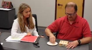 OT Student watches patient complete dexterity test