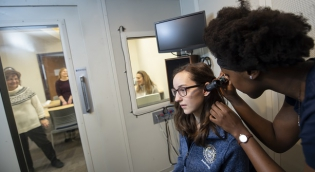 Students in hearing booth