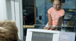 Child in Booth undergoing Hearing Test