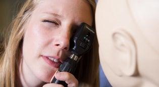 Student giving eye exam
