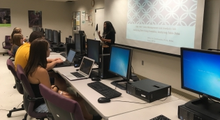 Instructor in computer lab teaching students