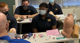 Emergency Medicine students learning about intubation