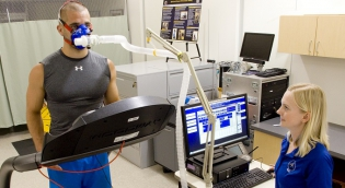 Student undergoing performance testing on treadmill in lab