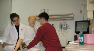 Students practice transfer techniques using simulated mannequins at the Peter M. Winter Institute for Simulation Education and Research (WISER) center