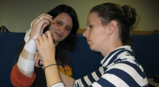 Students check the fit of a custom fabricated orthotic device during their splinting class