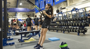 Female athlete training in weight room