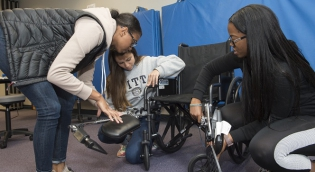 Students working with wheelchairs