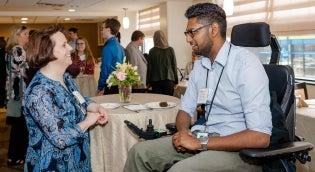Rehabilitation technology student talking with Beth Skidmore