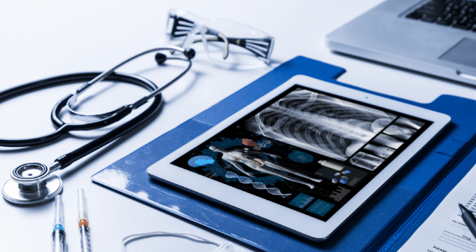 View of stethoscope and x-ray on i-pad
