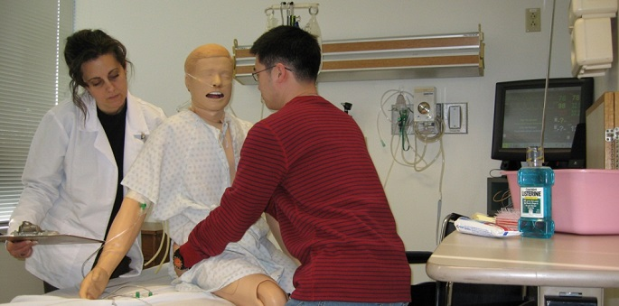Students practice transfer techniques using simulated mannequins at the WISER center
