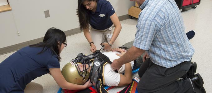 AT Students Practicing Spine Boarding