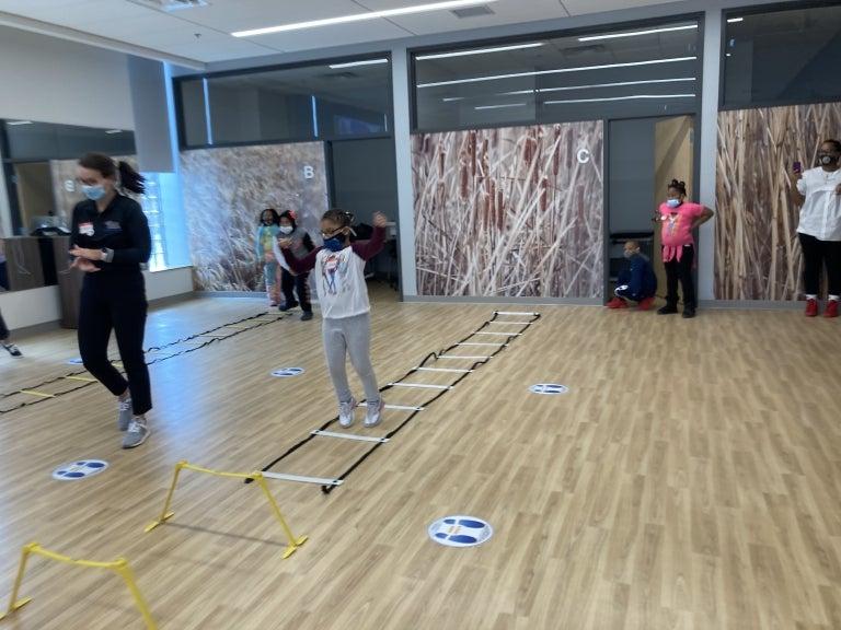 SHRS students instructing children at the Wellness Pavilion