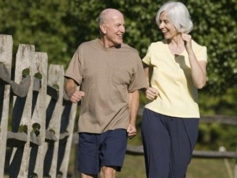 Older adult couple walking outside